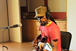 Ras Kerry recording his electric guitar in the live room.